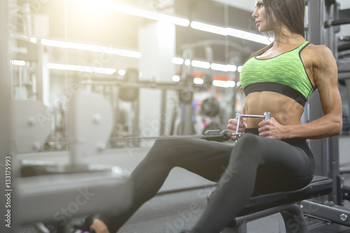 Fotografie, Tablou Sports background. Muscular fit woman exercising