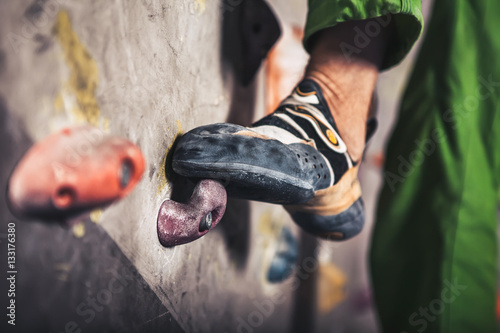 male foot on climbing wall Canvas Print