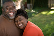 canvas print picture - Mature African American couple laughing and hugging.