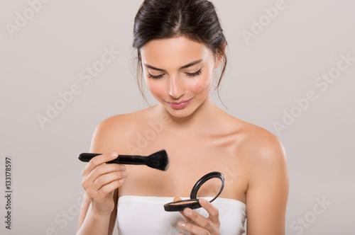 Fotografie, Obraz  Woman applying make up