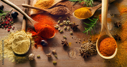 Various spices on wooden board.