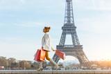 Fototapeta Fototapety z wieżą Eiffla - Young woman doing shopping in Paris