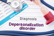 Diagnosis of Depersonalization disorder. On psychiatrist or psychologist table is paper with inscription Depersonalization disorder near psychiatric report, hourglass and stethoscope