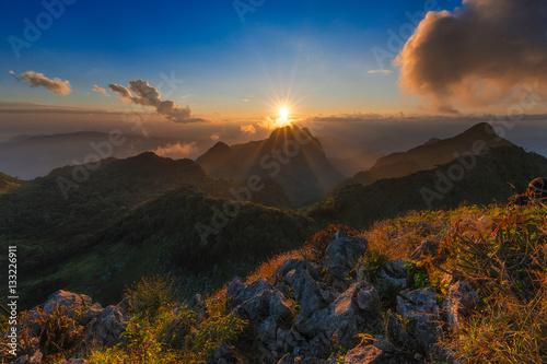 Spoed Foto op Canvas Grijze traf. Sun setting over the mountain at Chiangmai Thailand.