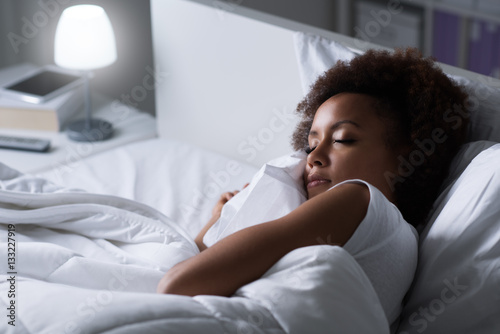 Woman sleeping in her bed Canvas Print