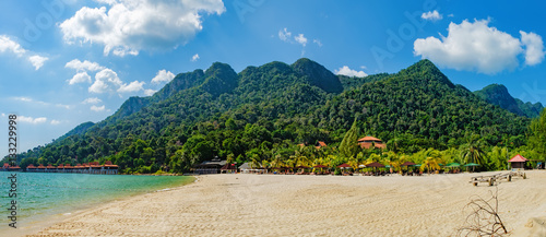 Foto op Canvas Tropical strand Relaxing on remote paradise beach. Tropical bungalow and luxury house on untouched sandy beach with palms trees in Langkawi Island, Malaysia.