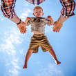 Young boy mid air, personal perspective