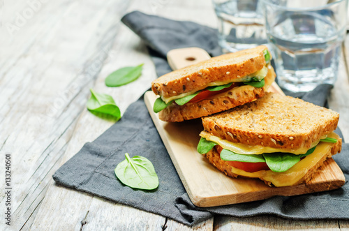 Staande foto Snack Spinach tomato cheese grilled rye sandwiches