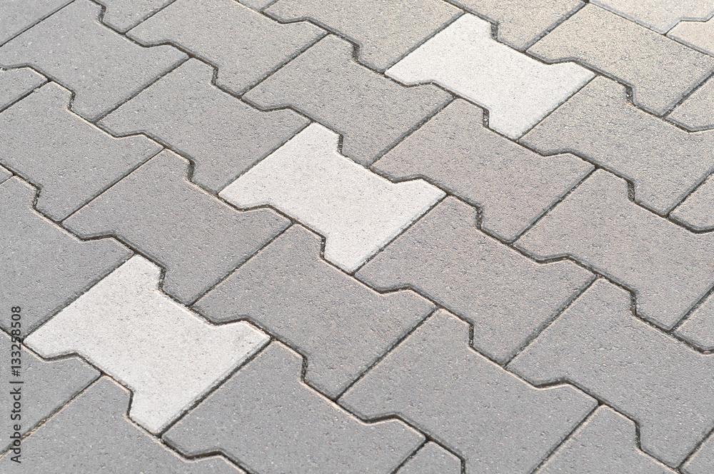 Fototapeta Verbundsteinpflaster mit grauen und weißen Betonsteinen, Betonprodukte, Pflasterarbeiten, großflächig, robust, praktisch und preiswert