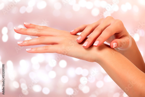 Beautiful woman hands against an abstract background