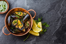 Mussels In Copper Bowl, Lemon, Herbs Sauce And White Wine.