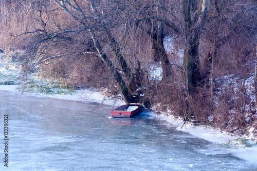 Poster Amusementspark old boat on frozen river