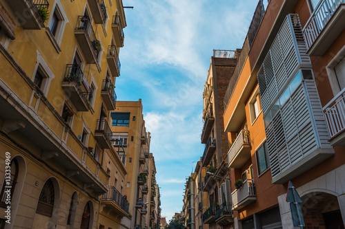 Modern And Old Apartment Buildings An A Small Alley At Barcelona