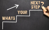 Hand writing the text: Whats Your Next Step