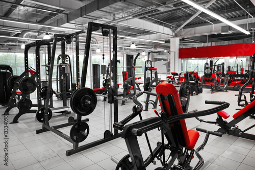 Poster Fitness Weight lifting machines in gym