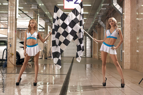 Zdjęcie XXL Hot leggy models with race flags at car wash