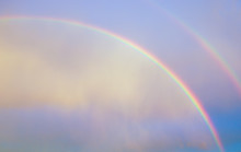 Double Rainbow In Early Morning Cloudy Sky Symbolizing God's Promise