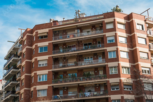 red brick apartment building with big balconies – kaufen Sie dieses ...
