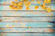 Leinwandbild Motiv Yellow flowers on vintage wooden background, border design. vintage color tone - concept flower of spring or summer background