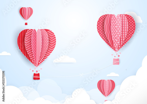 Hot air balloons in shape of heart flying in clouds. paper art a