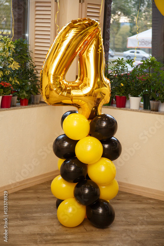 Birthday party for child four years old. Yellow and black