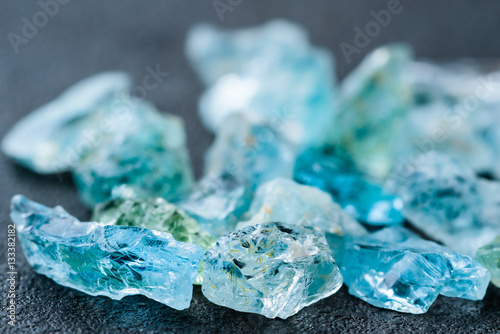 Collection of lovely blue uncut aquamarine gemstones.