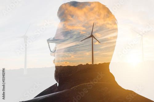 Fotografie, Obraz Double exposure portrait of a businessman thinking about renewable electricity c