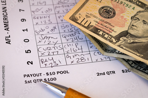 фотография  Detail of wager for Superbowl Pool grid with money