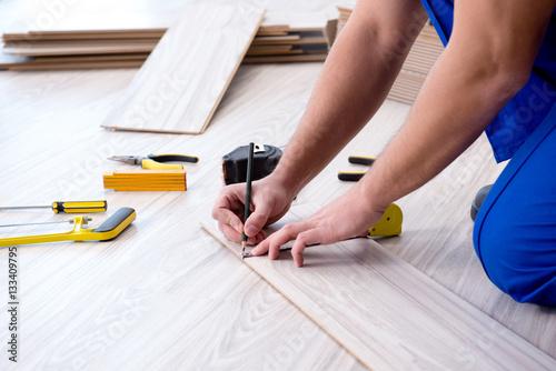 Obraz May laying laminate flooring at home - fototapety do salonu