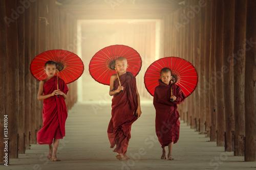 Photo  Burmaese Three novice monks walking