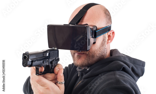 Man play VR shooter game with virtual reality gun and vr