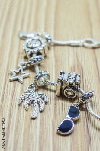 Photo  Pandora bracelet charms travel. Selective focus.