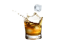 Whiskey Splash In A Glass Of Ice Cubes Falling, Isolated On White Background