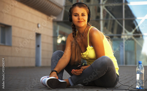 happy young attractive girl listening music with headphone