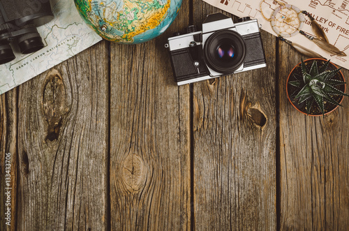 Obraz Accessories for travel top view on wooden background with copy space. Adventure and wanderlust concept image with travel accessories. Preparing for an exotic trip, journey and sightseeing. - fototapety do salonu