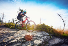 Female Mountain Biker Riding MTB Bike During Sunny Day In Mountains