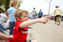 Boy Watching A Parade,