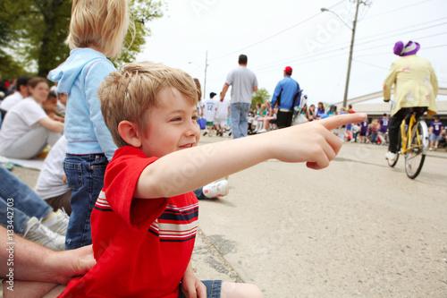 Boy watching a parade, Canvas Print