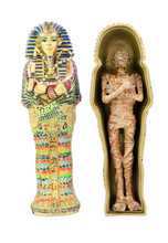Toy Model Of  Egyptian Sarcophagus And Mummy. Isolated.