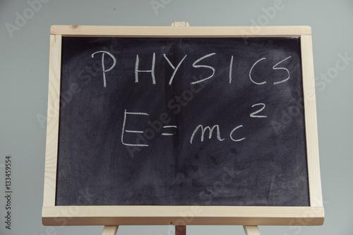 Physics word and formula E=mc2 on chalkboard Canvas Print