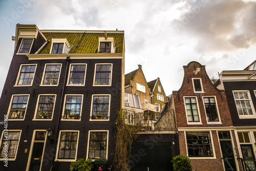 Foto op Aluminium New York AMSTERDAM, NETHERLANDS - JANUARY 10, 2017: Famous vintage buildings of Amsterdam city at sun set. General landscape view at tradition Dutch arcitecture. January 10, 2017 - Amsterdam - Netherlands..
