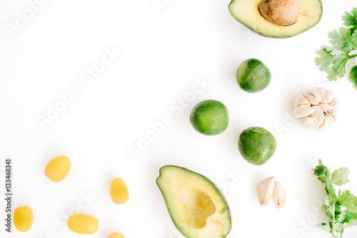 Raw food: avocado, coriander, cherry tomato, lime, garlic. Flat lay, top view. Food concept.