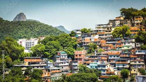 Christ looking at Favela (Shanty Town) in Rio De Janeiro, Brazil