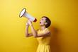 Leinwandbild Motiv Female model using bullhorn in photo session