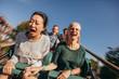 Leinwanddruck Bild - Friends cheering and riding roller coaster at amusement park