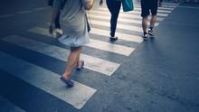 Motion Of Pedestrian Zebra Crossing Or Crosswalk In Asia. Feet Of The Pedestrians Crossing On City Street Closeup.