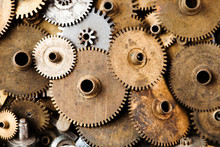 Steampunk Gears Background. Aged Mechanical Clock Wheels Close-up. Shallow Depth Field, Soft Focus.