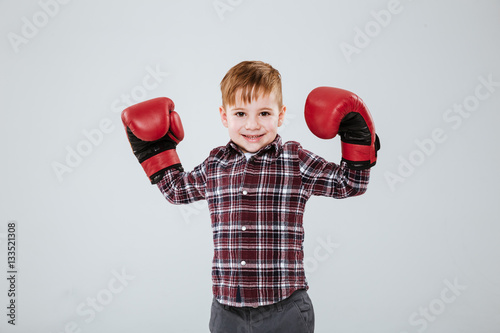 925816c99bf0d Happy little boy in boxing gloves standing with raised hands - Buy ...