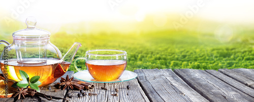 Valokuvatapetti Tea Time With Plantation Of Tea Background