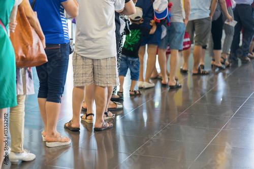 Fényképezés  Closeup Queue of Asian people waiting at boarding gate at airport